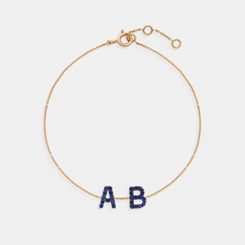 Bracciale personalizzato in oro giallo e letterine in zaffiri - Rosanna Cattolico gioielli